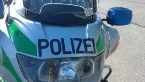 grün-silbernes Motorrad der Polizei